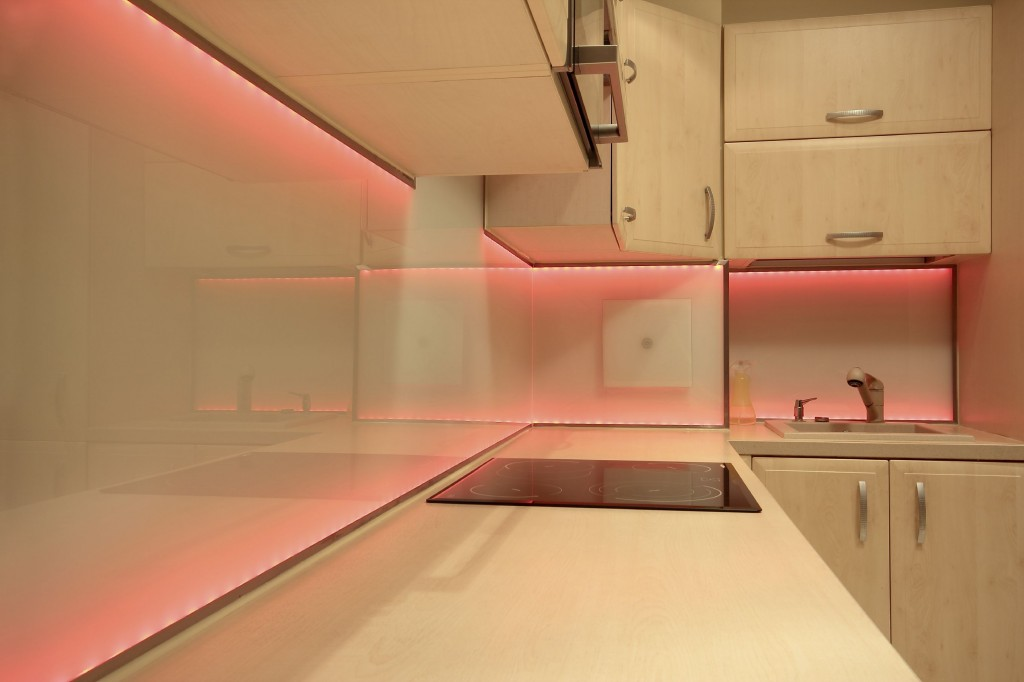 Modern luxury kitchen with red LED lighting